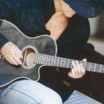 Joe Lara playing guitar